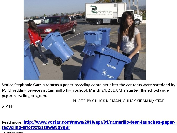 Senior Stephanie Garcia returns a paper recycling container after the contents were shredded by