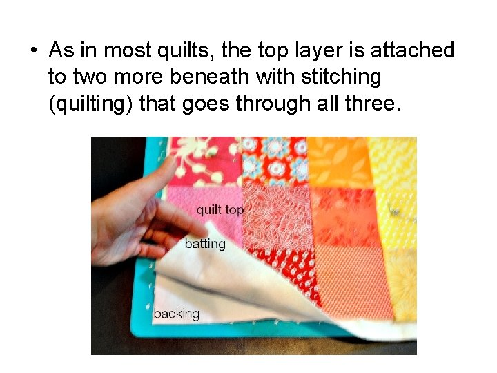 • As in most quilts, the top layer is attached to two more