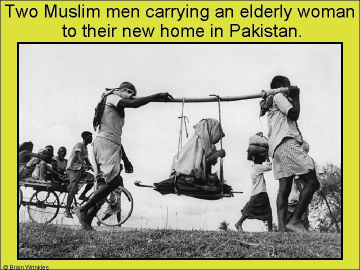 Two Muslim men carrying an elderly woman to their new home in Pakistan. ©