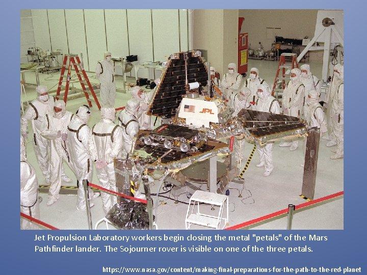 "Jet Propulsion Laboratory workers begin closing the metal ""petals"" of the Mars Pathfinder lander."