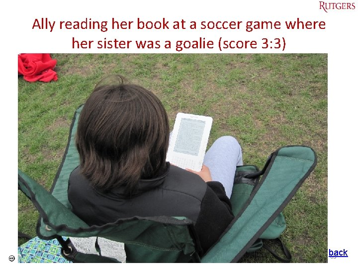 Ally reading her book at a soccer game where her sister was a goalie