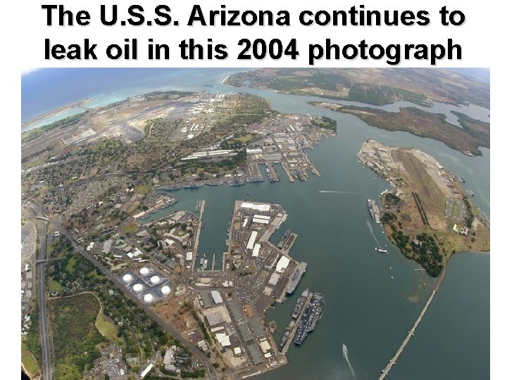 The U. S. S. Arizona continues to leak oil in this 2004 photograph