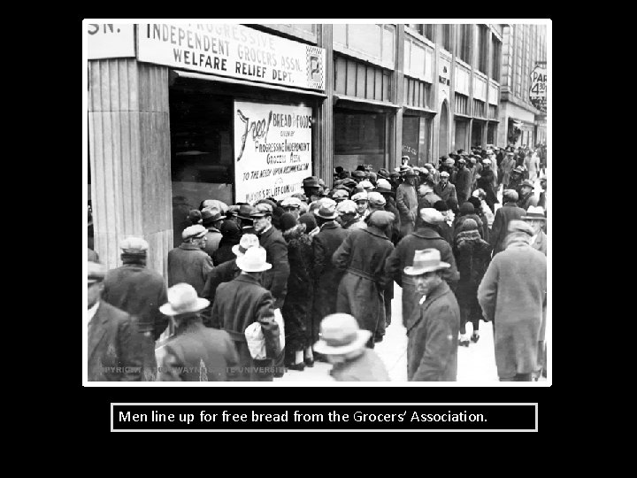 Men line up for free bread from the Grocers' Association.