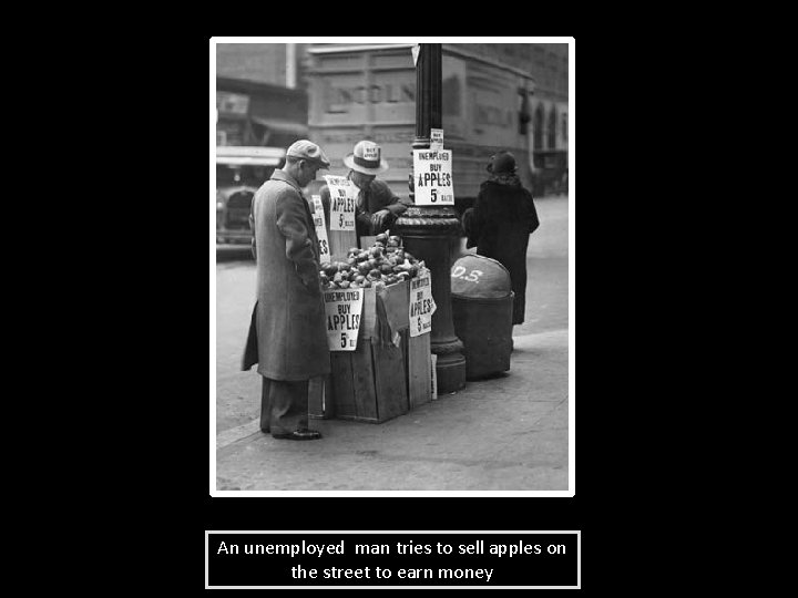 An unemployed man tries to sell apples on the street to earn money