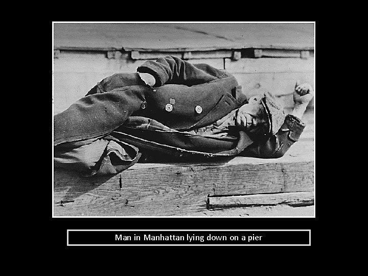 Man in Manhattan lying down on a pier