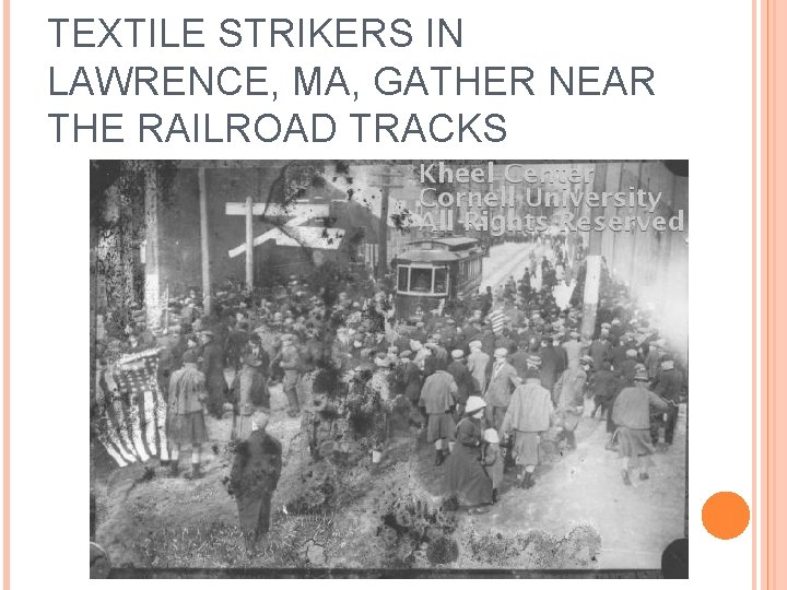 TEXTILE STRIKERS IN LAWRENCE, MA, GATHER NEAR THE RAILROAD TRACKS