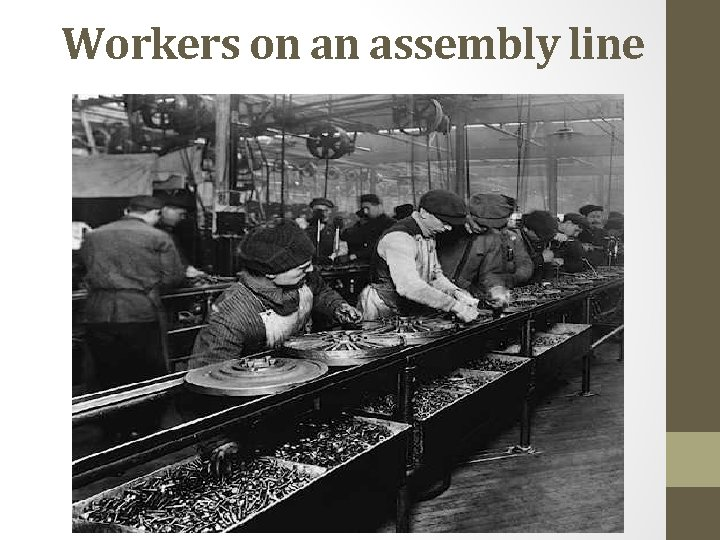 Workers on an assembly line