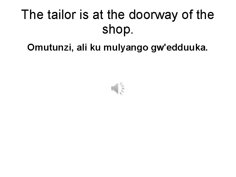 The tailor is at the doorway of the shop. Omutunzi, ali ku mulyango gw'edduuka.