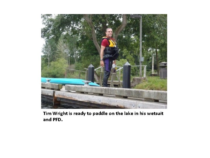 Tim Wright is ready to paddle on the lake in his wetsuit and PFD.