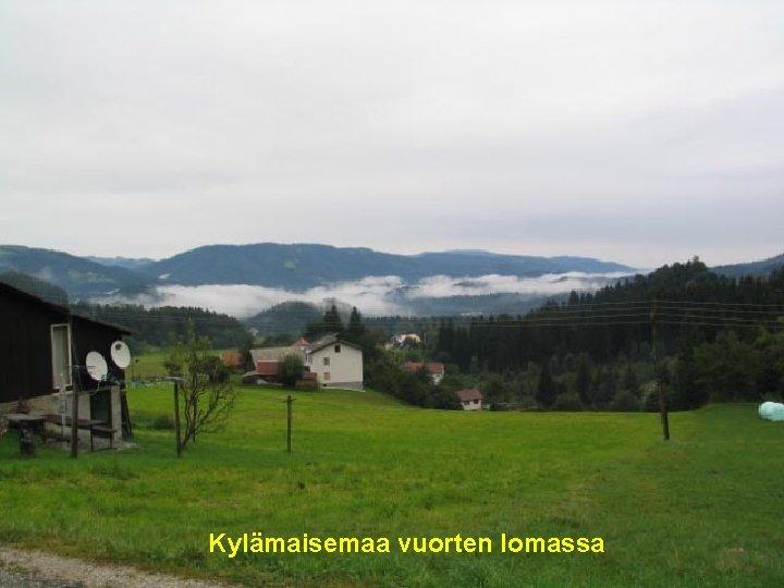 . Kylämaisemaa vuorten lomassa