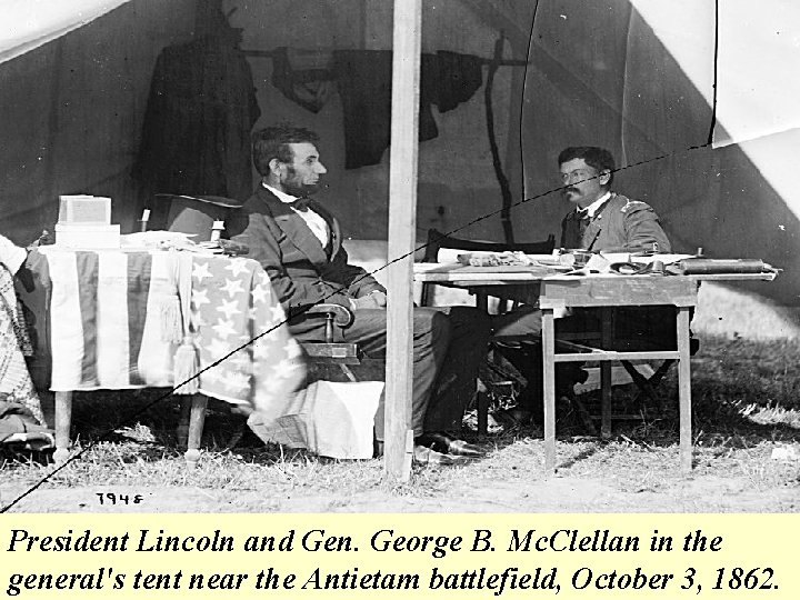 President Lincoln and Gen. George B. Mc. Clellan in the general's tent near the