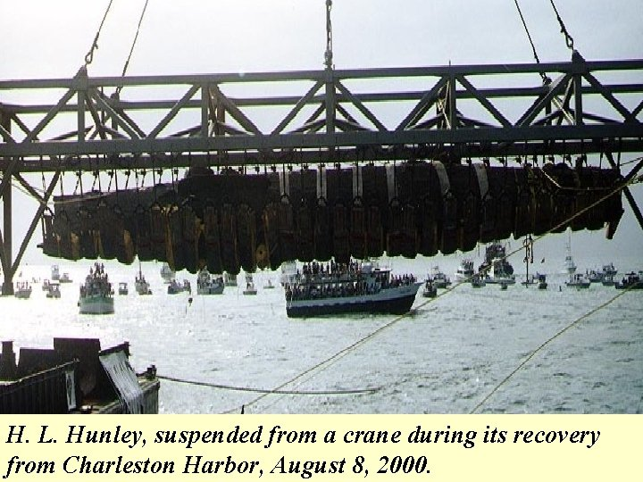 H. L. Hunley, suspended from a crane during its recovery from Charleston Harbor, August
