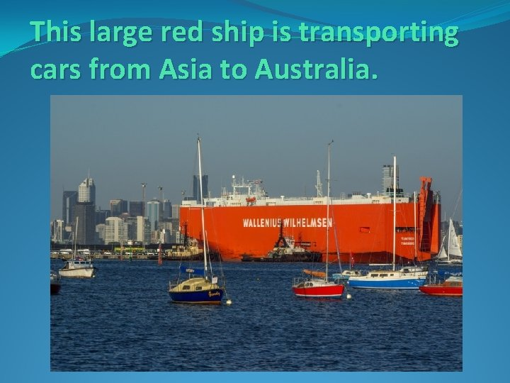 This large red ship is transporting cars from Asia to Australia.