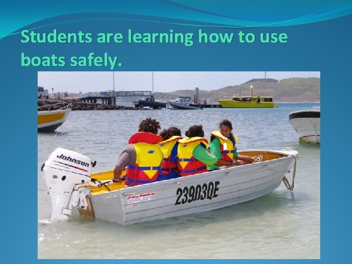 Students are learning how to use boats safely.
