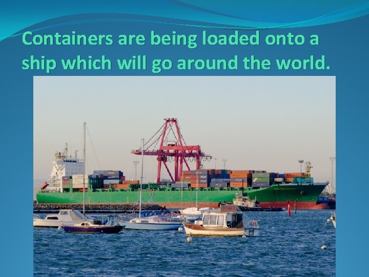 Containers are being loaded onto a ship which will go around the world.
