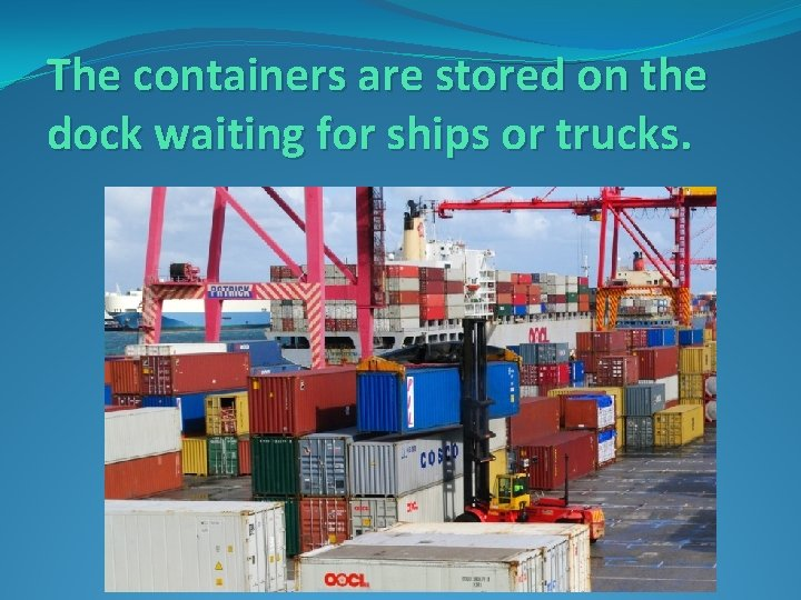 The containers are stored on the dock waiting for ships or trucks.