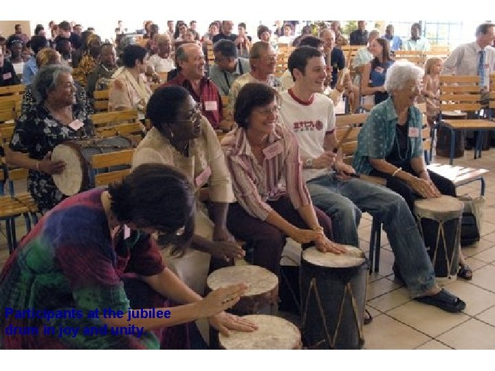 Participants at the jubilee drum in joy and unity.