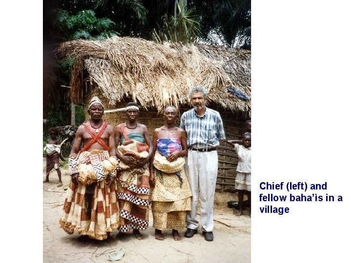 Chief (left) and fellow baha'ìs in a village