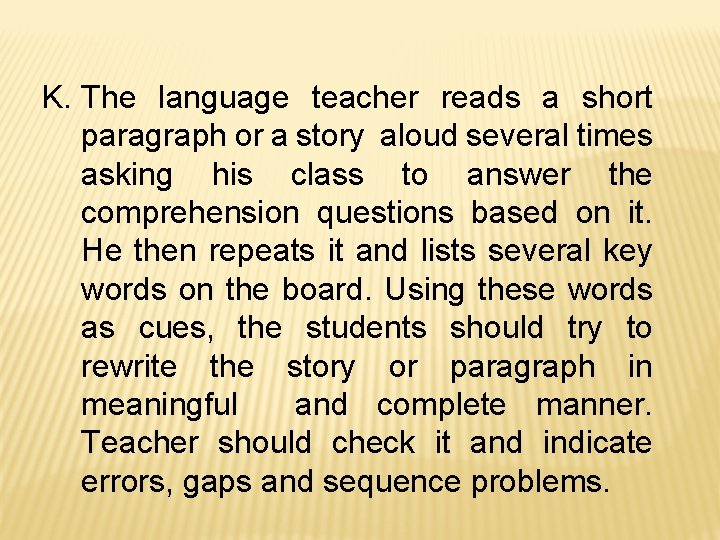 K. The language teacher reads a short paragraph or a story aloud several times
