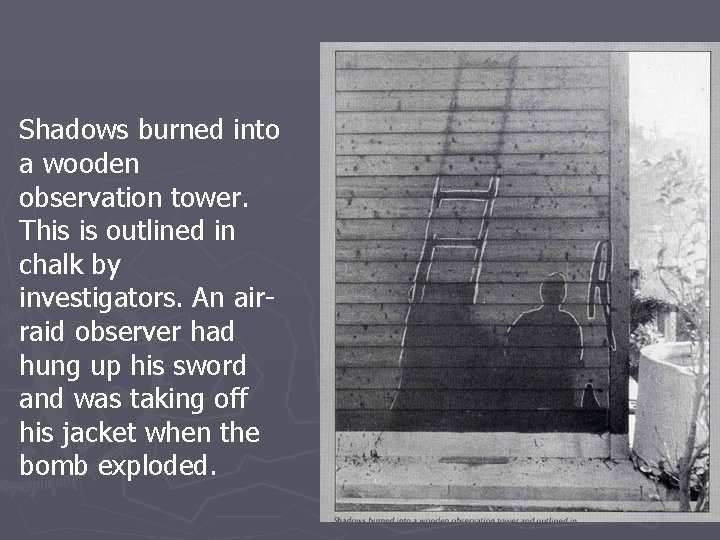 Shadows burned into a wooden observation tower. This is outlined in chalk by investigators.