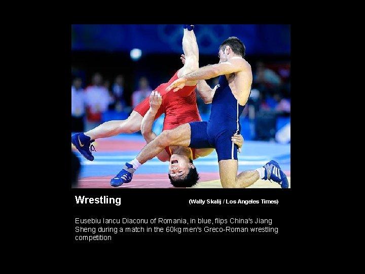 Wrestling (Wally Skalij / Los Angeles Times) Eusebiu Iancu Diaconu of Romania, in blue,