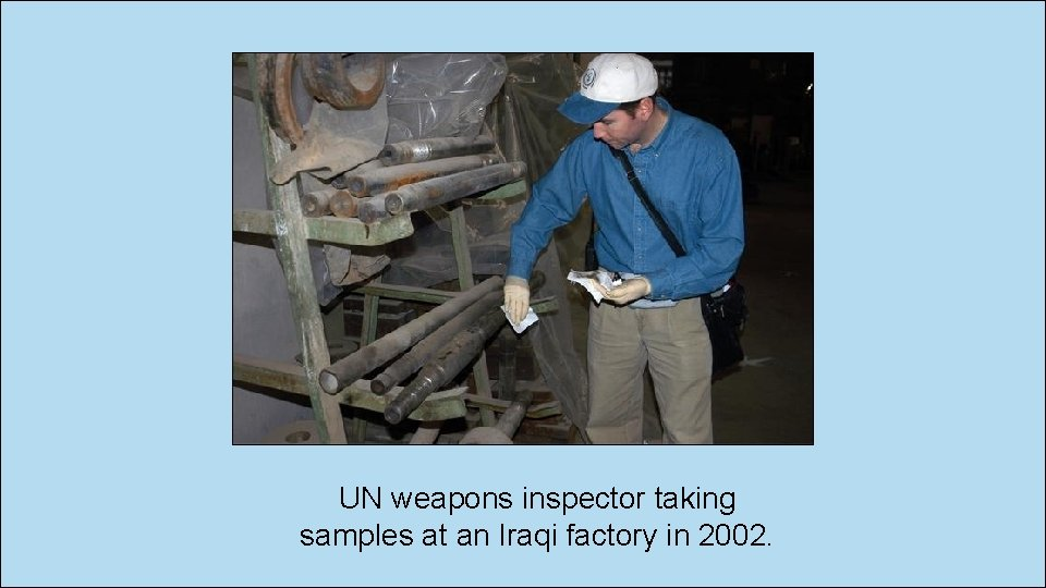 UN weapons inspector taking samples at an Iraqi factory in 2002.