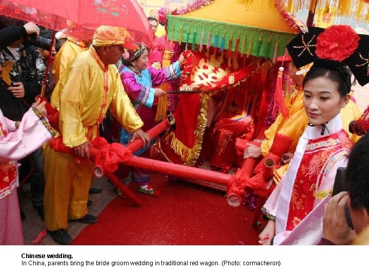 Chinese wedding. In China, parents bring the bride groom wedding in traditional red wagon.