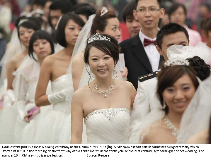 Couples take part in a mass wedding ceremony at the Olympic Park in Beijing.