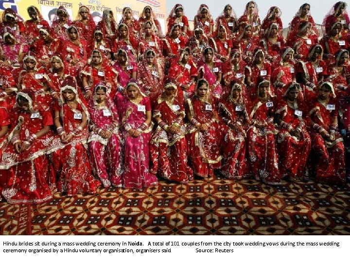 Hindu brides sit during a mass wedding ceremony in Noida. A total of 101