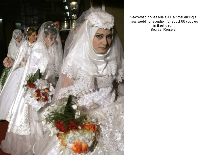 Newly-wed brides arrive AT a hotel during a mass wedding reception for about 60