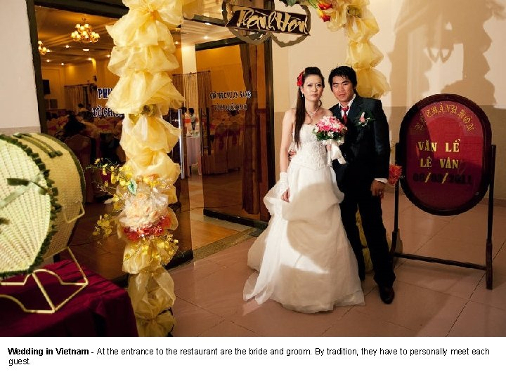 Wedding in Vietnam - At the entrance to the restaurant are the bride and