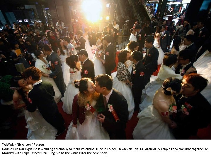 TAIWAN - Nicky Loh / Reuters Couples kiss during a mass wedding ceremony to