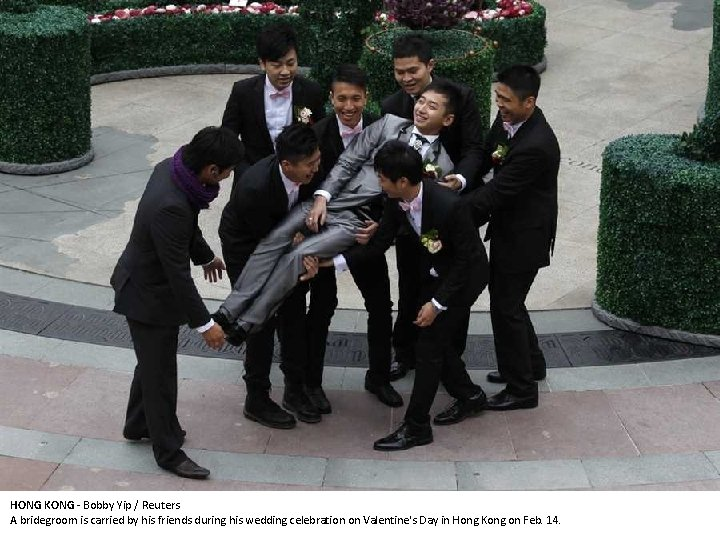 HONG KONG - Bobby Yip / Reuters A bridegroom is carried by his friends