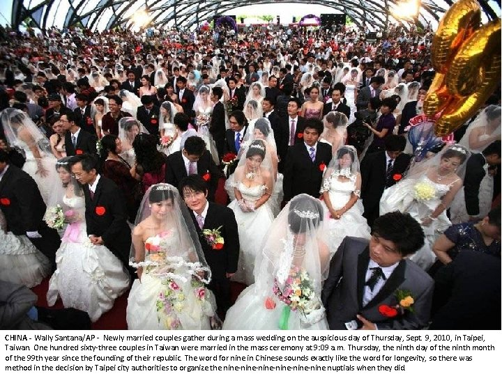 CHINA - Wally Santana/AP - Newly married couples gather during a mass wedding on
