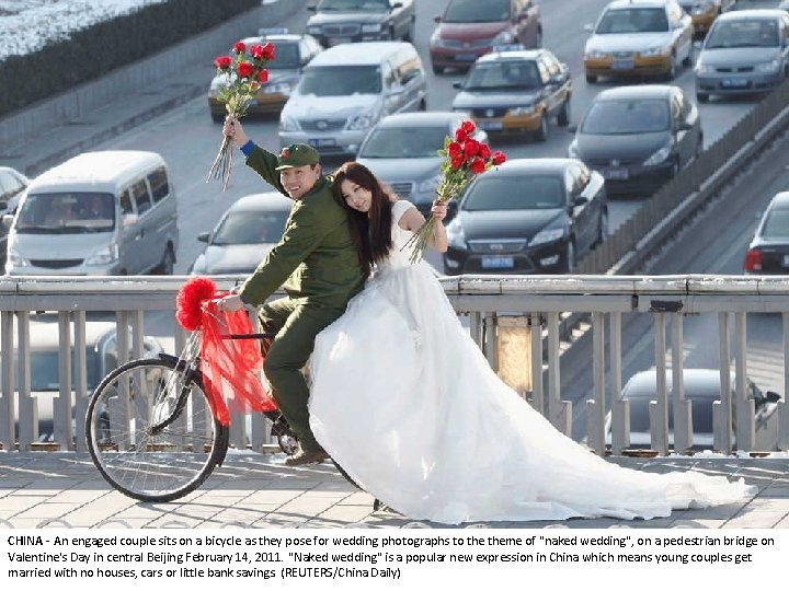 CHINA - An engaged couple sits on a bicycle as they pose for wedding