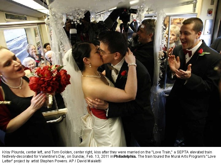Krisy Plourde, center left, and Tom Golden, center right, kiss after they were married