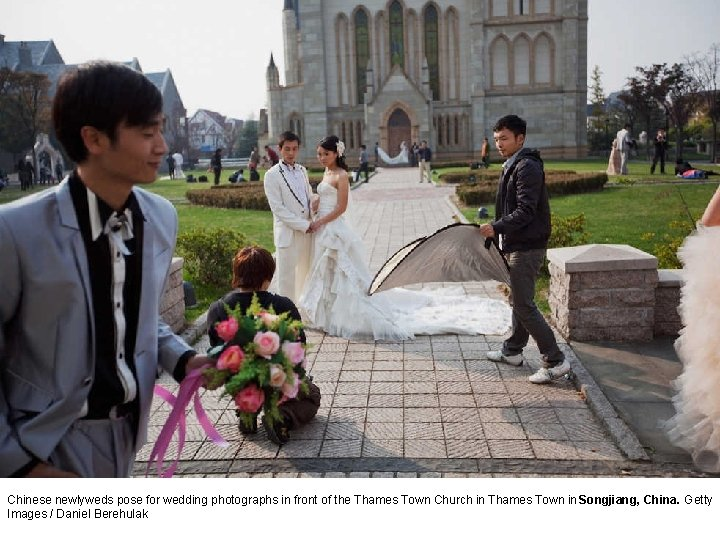 Chinese newlyweds pose for wedding photographs in front of the Thames Town Church in