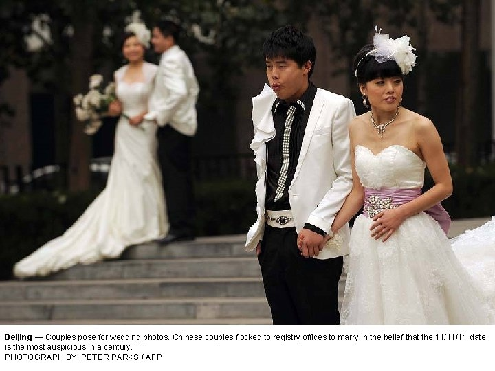 Beijing — Couples pose for wedding photos. Chinese couples flocked to registry offices to