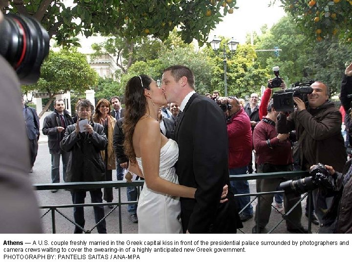 Athens — A U. S. couple freshly married in the Greek capital kiss in