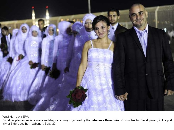 Wael Hamzeh / EPA Bridal couples arrive for a mass wedding ceremony organized by