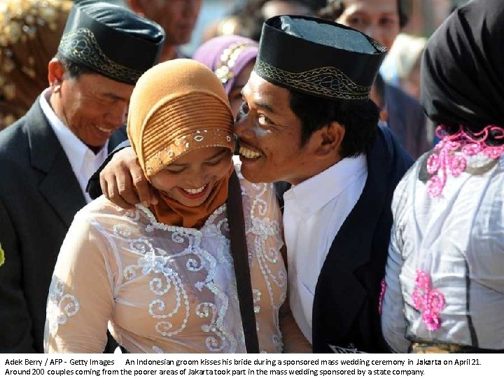 Adek Berry / AFP - Getty Images An Indonesian groom kisses his bride during