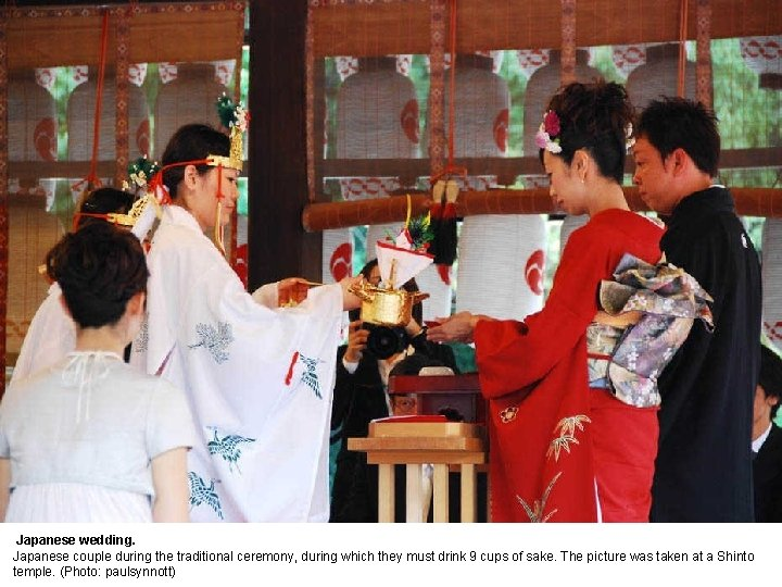 Japanese wedding. Japanese couple during the traditional ceremony, during which they must drink 9